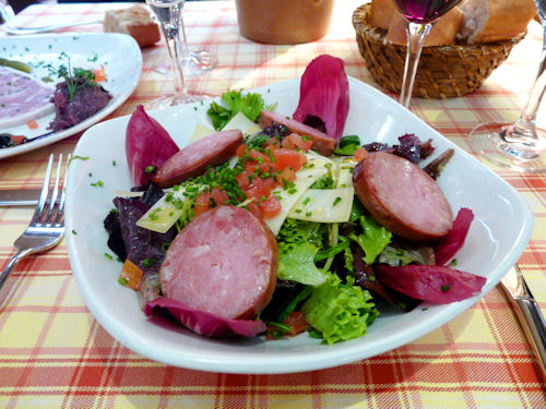 Salad with local sausages and cheese