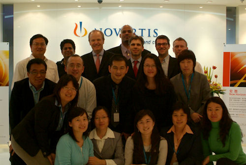 Posing together with the team in China