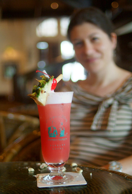 Aude poses with a Singapore Sling