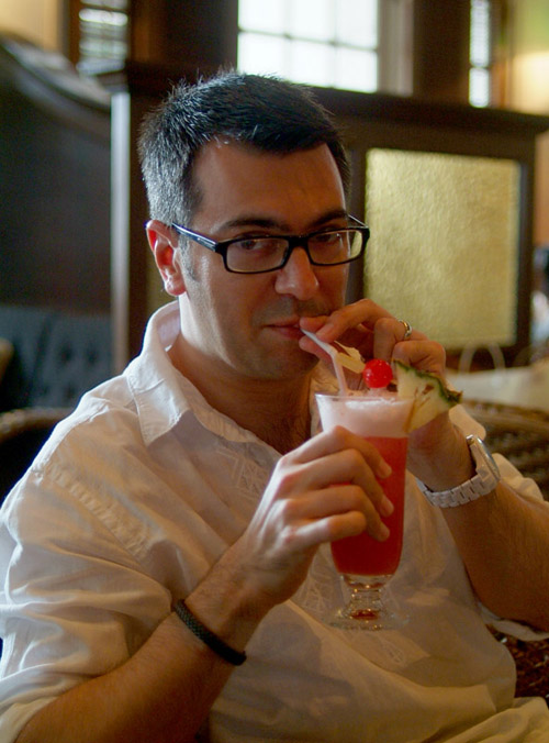 Matthew drinking a Singapore Sling at Raffles Hotel