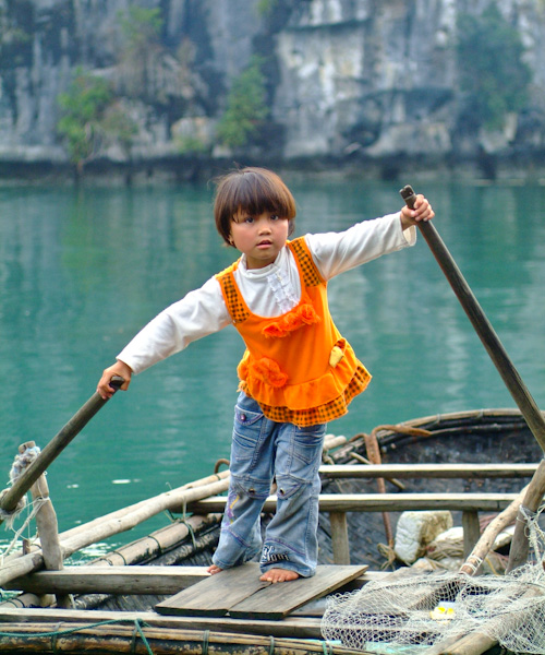 Little girl in rowboat in Halong Bay