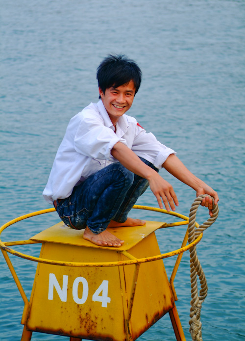 Vietnamese boathand at mooring