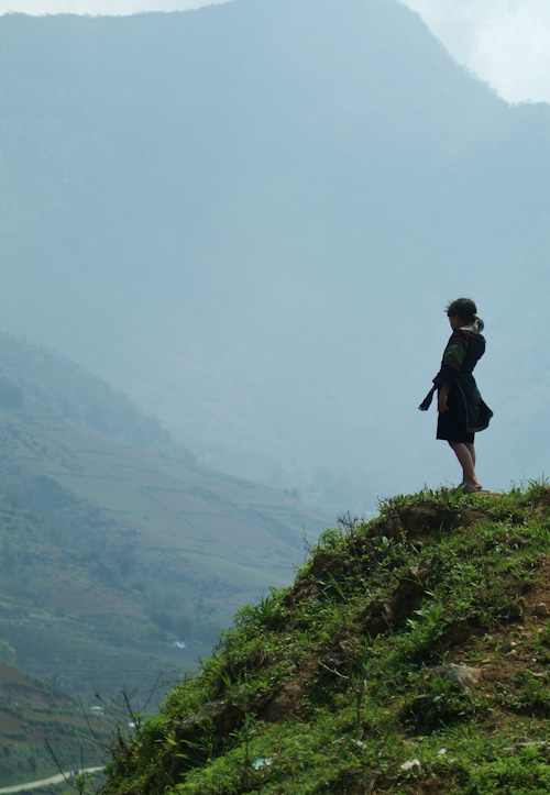Hmong girl reflecting on a hillside